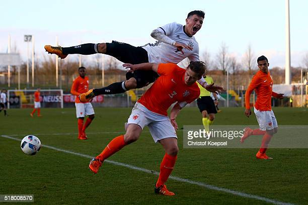 Matthijs de Ligt of the Netherlands challenges Renat Dadachov of Germany during the U17 Euro Qualification match between Germany and Netherlands at...