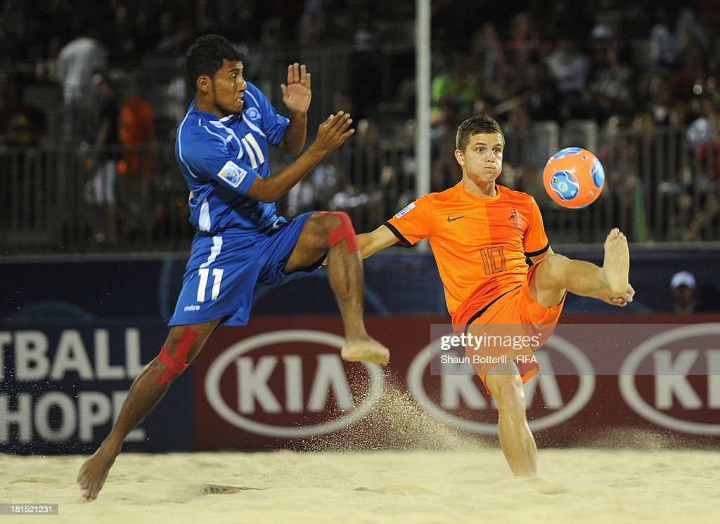 Matthijs Van Gessel of Netherlands is challenged by Frank Velasquez of El Salvador during the FIFA Beach Soccer World Cup Tahiti 2013 Group B match between El Salvador and Netherlands at the Tahua To'ata stadium on September 21, 2013 in Papeete, French Polynesia.