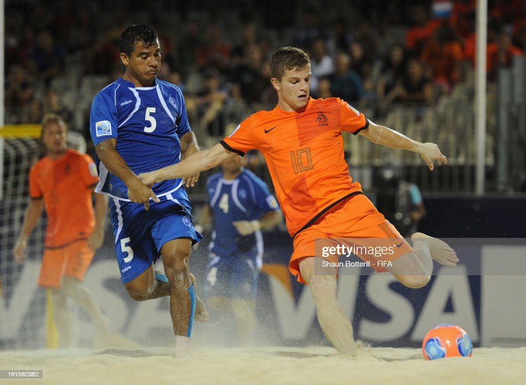 Matthijs Van Gessel of Netherlands is challenged by Jose Membreno of El Salvador during the FIFA Beach Soccer World Cup Tahiti 2013 Group B match between El Salvador and Netherlands at the Tahua To'ata stadium on September 21, 2013 in Papeete, French Polynesia.