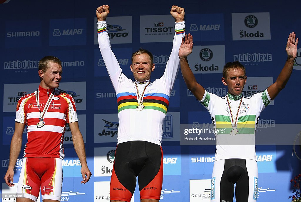<a gi-track='captionPersonalityLinkClicked' href=/galleries/search?phrase=Matti+Breschel&family=editorial&specificpeople=595999 ng-click='$event.stopPropagation()'>Matti Breschel</a> of Denmark, <a gi-track='captionPersonalityLinkClicked' href=/galleries/search?phrase=Thor+Hushovd&family=editorial&specificpeople=534471 ng-click='$event.stopPropagation()'>Thor Hushovd</a> of Norway and Allan Davis of Australia celebrate after the Elite Men's Road Race on day five of the UCI Road World Championships on October 3, 2010 in Geelong, Australia.