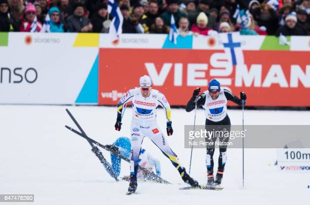 Matti Heikkinen of Finland as Calle Halfvarsson of Sweden sprints for the bronze medal during the men's cross country relay during the FIS Nordic...