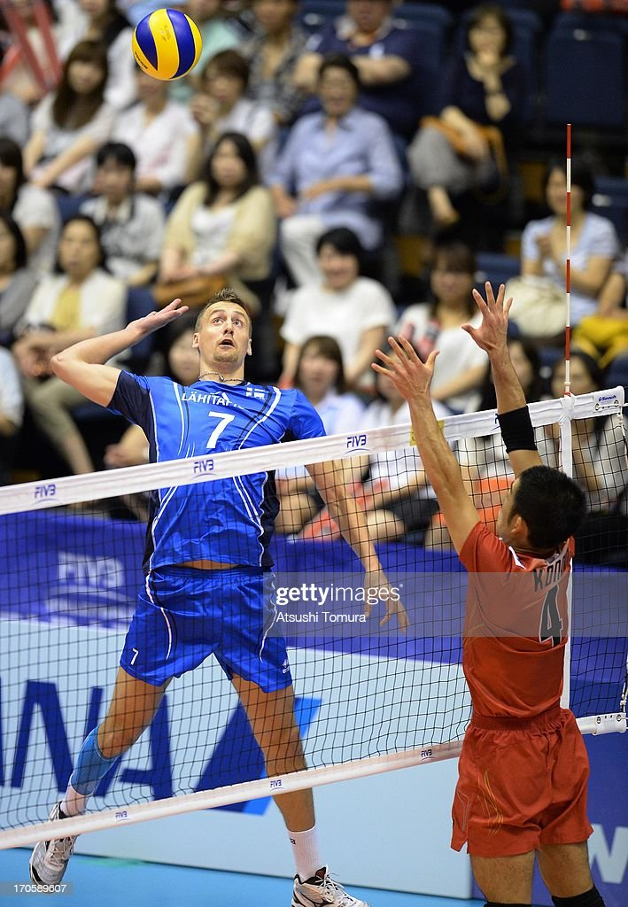 Matti Hietanen of Finland spikes the ball against Shigeru Kondoh of Japan during the FIVB World League Pool C match between Japan and Finland at Park Arena Komaki on June 15, 2013 in Komaki, Japan.