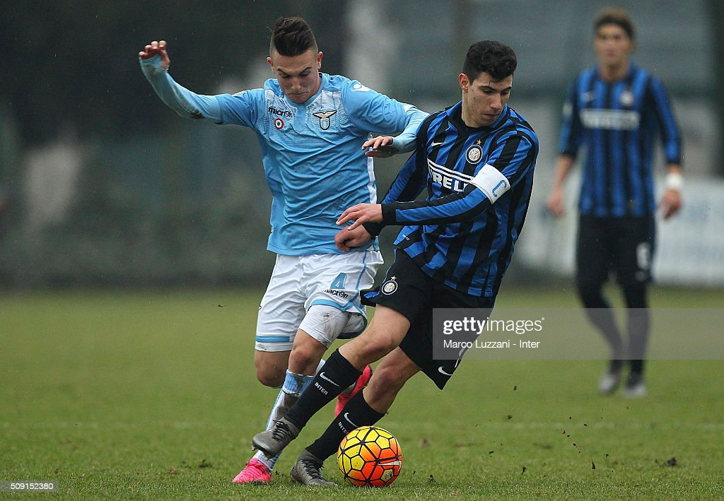 Mattia Bonetto (R) of FC Internazionale Milano competes for the ball with Mika Mario Rokavec (L) of SS Lazio during the juvenile TIM cup match between FC Internazionale and SS Lazio at Stadio Breda on February 9, 2016 in Sesto San Giovanni, Italy.