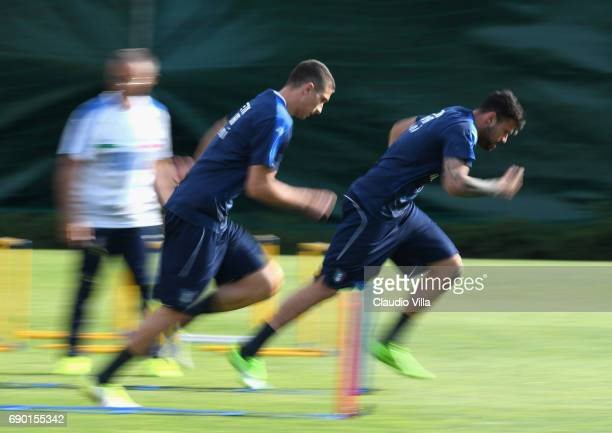 Mattia Caldara and Andrea Petagna of Italy in action during the training session at Coverciano at Coverciano on May 30 2017 in Florence Italy