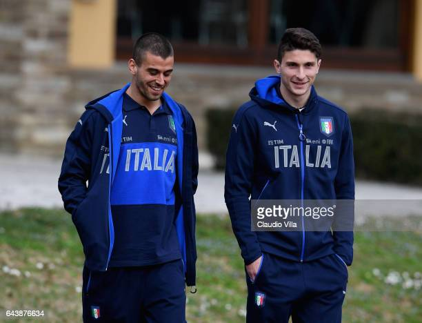 Mattia Caldara and Leonardo Spinazzola of Italy chat prior to the training session at the club's training ground at Coverciano on February 22 2017 in...