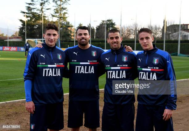 Mattia Caldara Andrea Petagna Leonardo Spinazzola and Andrea Conti of Italy pose for a photo prior to the official portrait session at Coverciano on...
