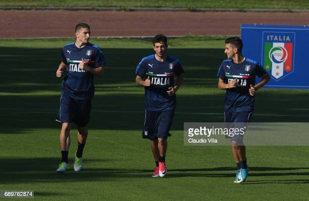 Mattia Caldara Danilo Cataldi and Lorenzo Pellegrini of Italy in action during a training session at Coverciano at Coverciano on May 29 2017 in...