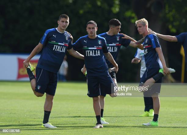 Mattia Caldara Davide Calabria and Andrea Conti of Italy in action during the training session at Coverciano at Coverciano on May 30 2017 in Florence...