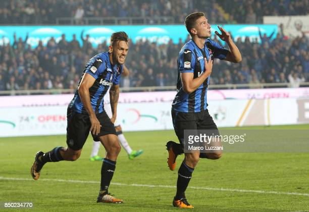 Mattia Caldara of Atalanta BC celebrates his goal with his teammate Rafael Toloi during the Serie A match between Atalanta BC and FC Crotone at...