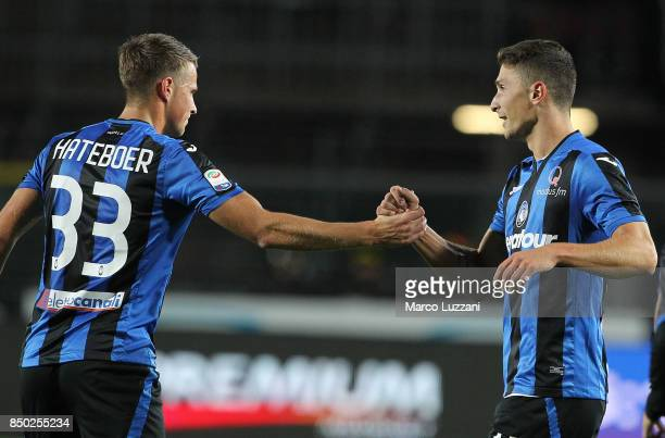 Mattia Caldara of Atalanta BC celebrates his goal with his teammate Hans Hateboer during the Serie A match between Atalanta BC and FC Crotone at...