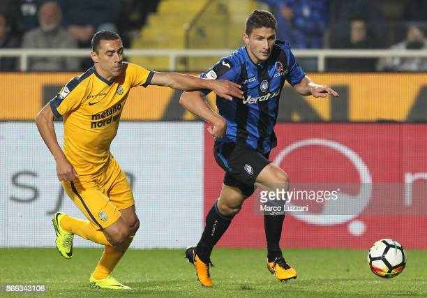 Mattia Caldara of Atalanta BC competes for the ball with Romulo of Hellas Verona FC during the Serie A match between Atalanta BC and Hellas Verona FC...
