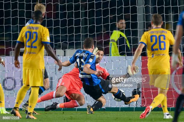 Mattia Caldara of Atalanta BC scores a goal during the Serie A football match between Atalanta BC and Juventus FC The match end in a tie 22