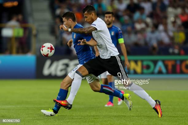 Mattia Caldara of Italy and Davie Selke of Germany battle for the ball during the UEFA U21 championship match between Italy and Germany at Krakow...