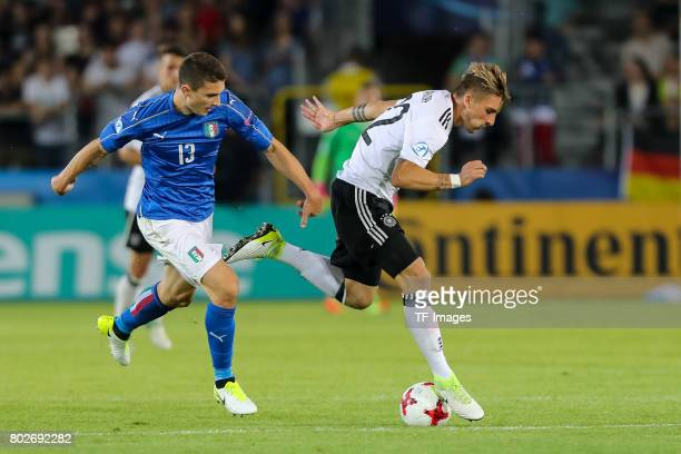 Mattia Caldara of Italy and Maximilian Philipp of Germany battle for the ball during the UEFA U21 championship match between Italy and Germany at...