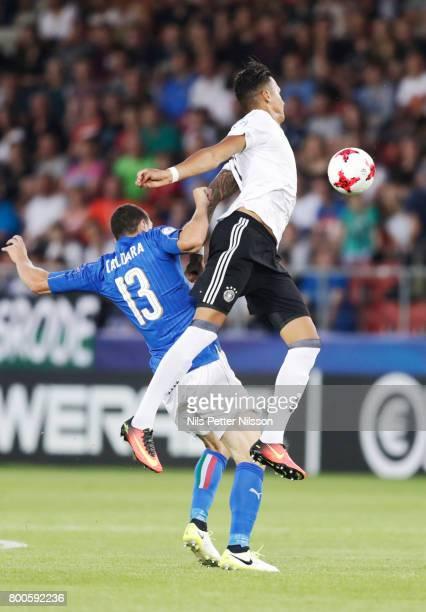 Mattia Caldara of Italy and Serge Gnabry of Germany during the UEFA U21 championship match between Italy and Germany at Krakow Stadium on June 24...