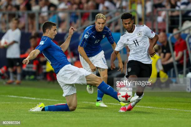 Mattia Caldara of Italy Andrea Conti of Italy and Serge Gnabry of Germany battle for the ball during the UEFA U21 championship match between Italy...