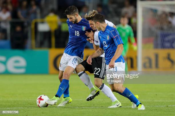 Mattia Caldara of Italy Roberto Gagliardini of Italy and Maximilian Philipp of Germany battle for the ball during the UEFA U21 championship match...