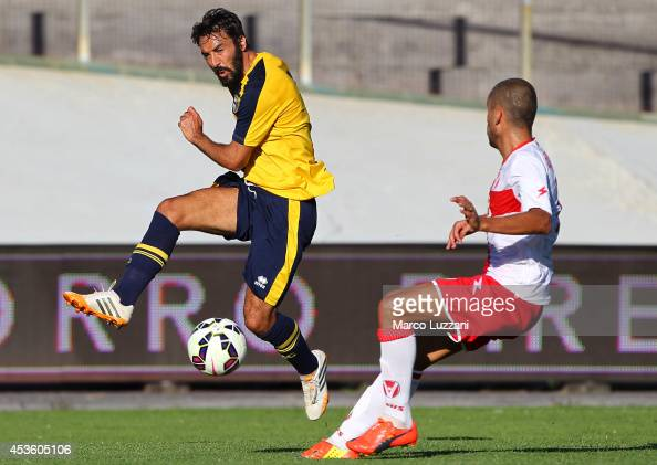 Mattia Cassani of FC Parma is challenged by Nunzio Di Roberto of AS Varese during the preseason friendly match between AS Varese and FC Parma at...