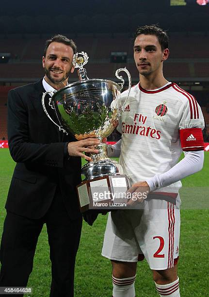 Mattia De Sciglio and Giampaolo Pazzini of AC Milan with the Luigi Berlusconi trophy at the end of the Luigi Berlusconi Trophy at Stadio Giuseppe...