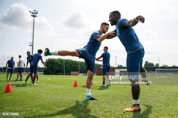 Mattia De Sciglio and Kwadwo Asamoah of Juventus during a training session on August 9 2017 in Vinovo Italy