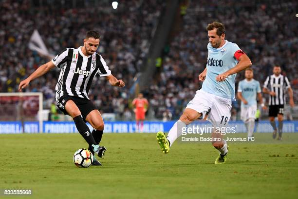 Mattia De Sciglio and Senad Lulic during the Italian Supercup match between Juventus and SS Lazio at Stadio Olimpico on August 13 2017 in Rome Italy