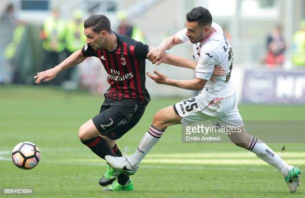 Mattia De Sciglio of AC Milan competes for the ball with Bruno Henrique Corsini of US Citta di Palermo during the Serie A match between AC Milan and...