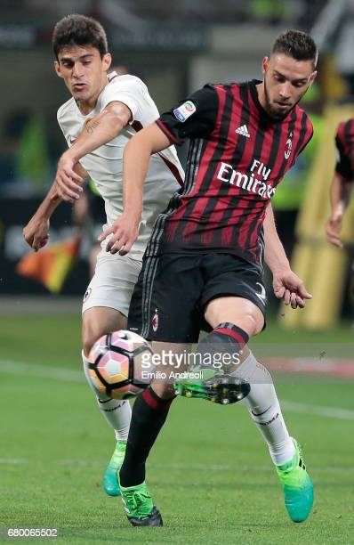 Mattia De Sciglio of AC Milan competes for the ball with Diego Perotti of AS Roma during the Serie A match between AC Milan and AS Roma at Stadio...