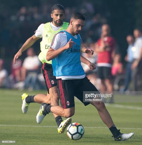 Mattia De Sciglio of AC Milan competes for the ball with his teammate Ricardo Rodriguez during the AC Milan training session at the club's training...