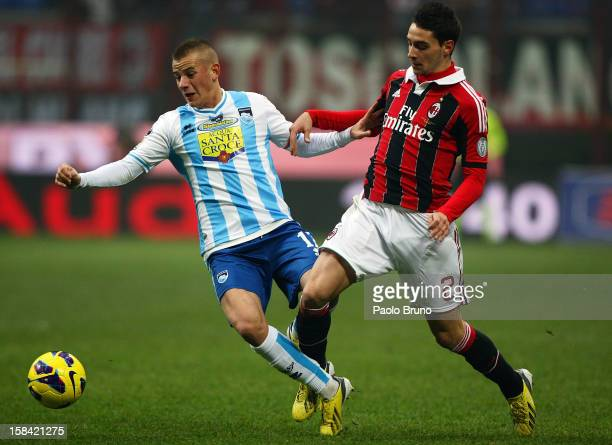 Mattia De Sciglio of AC Milan competes for the ball with Vladimir Weiss of Pescara during the Serie A match between AC Milan and Pescara at San Siro...