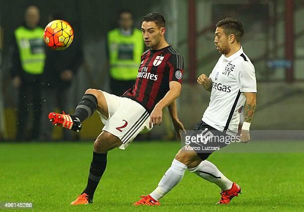 Mattia De Sciglio of AC Milan is challenged by Alejandro Dario Gomez of Atalanta BC during the Serie A match between AC Milan and Atalanta BC at...