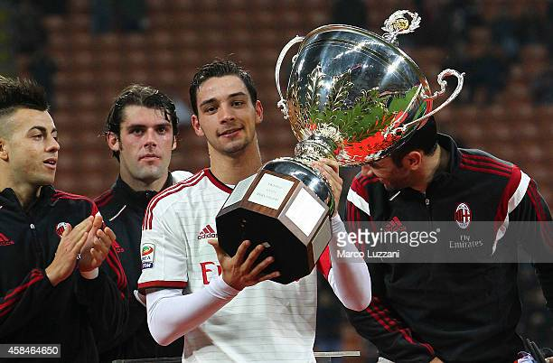 Mattia De Sciglio of AC Milan lifts the trophy following the Luigi Berlusconi Trophy at Stadio Giuseppe Meazza on November 5 2014 in Milan Italy