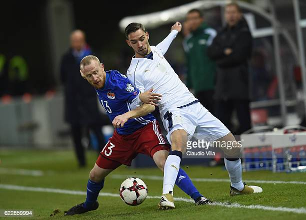 Mattia De Sciglio of Italy competes for the ball with Martin Buchel of Liechtenstein during the FIFA World Cup 2018 group G Qualifiers football match...
