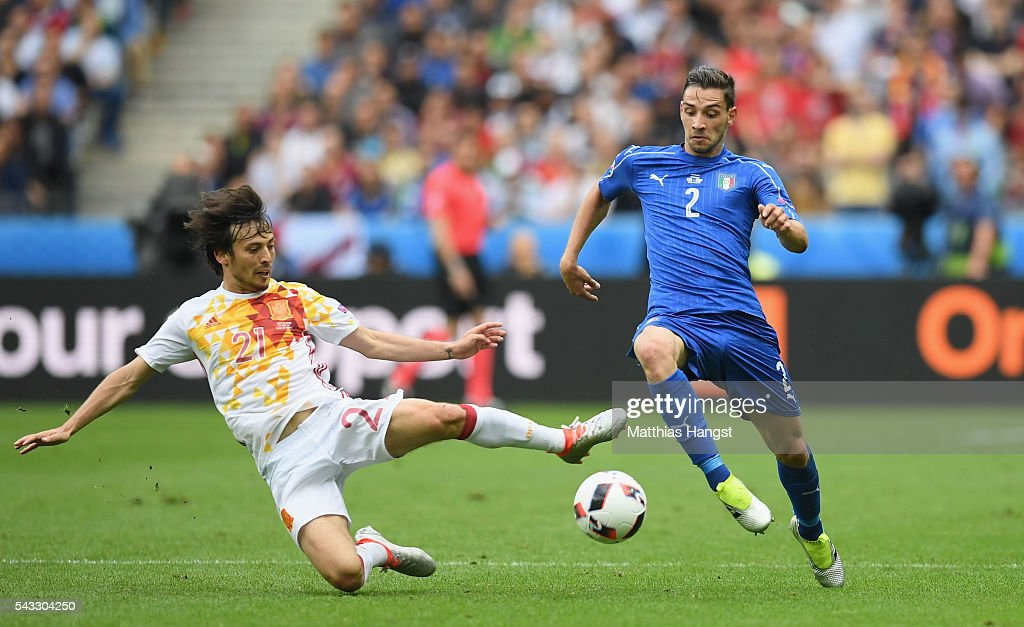 <a gi-track='captionPersonalityLinkClicked' href=/galleries/search?phrase=Mattia+De+Sciglio&family=editorial&specificpeople=8709670 ng-click='$event.stopPropagation()'>Mattia De Sciglio</a> of Italy is tackled by <a gi-track='captionPersonalityLinkClicked' href=/galleries/search?phrase=David+Silva&family=editorial&specificpeople=675795 ng-click='$event.stopPropagation()'>David Silva</a> of Spain during the UEFA EURO 2016 round of 16 match between Italy and Spain at Stade de France on June 27, 2016 in Paris, France.