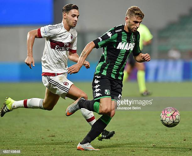 Mattia De Sciglio of Milan and Domenico Berardi of Sassuolo in action during the TIM preseason tournament match between AC Milan and US Sassuolo...
