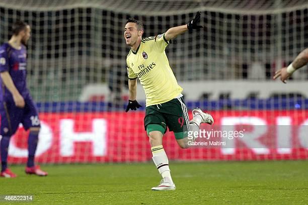 Mattia Destro of AC Milan celebrates after scoring a goal during the Serie A match between ACF Fiorentina and AC Milan at Stadio Artemio Franchi on...
