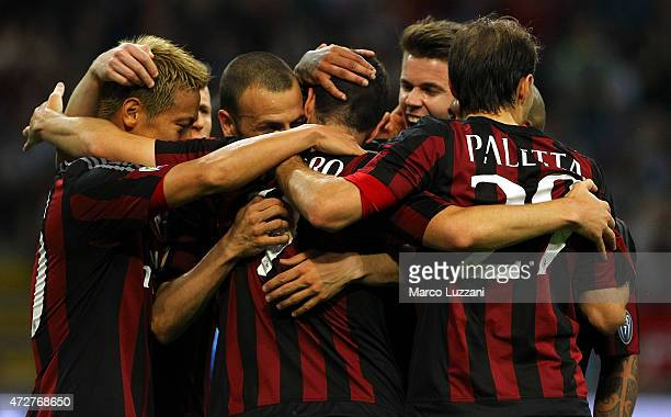 Mattia Destro of AC Milan celebrates his goal with his teammates during the Serie a match between AC Milan and AS Roma at Stadio Giuseppe Meazza on...