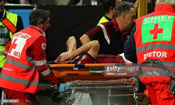 Mattia Destro of AC Milan is helped from the pitch after sustaining an injury during the Serie A match between AC Milan and UC Sampdoria at Stadio...