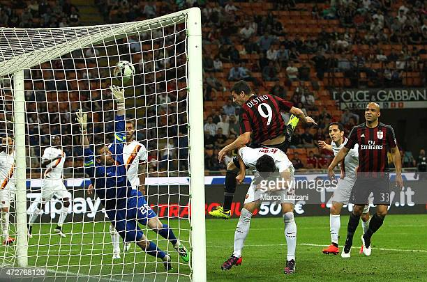 Mattia Destro of AC Milan scores a goal during the Serie a match between AC Milan and AS Roma at Stadio Giuseppe Meazza on May 9 2015 in Milan Italy