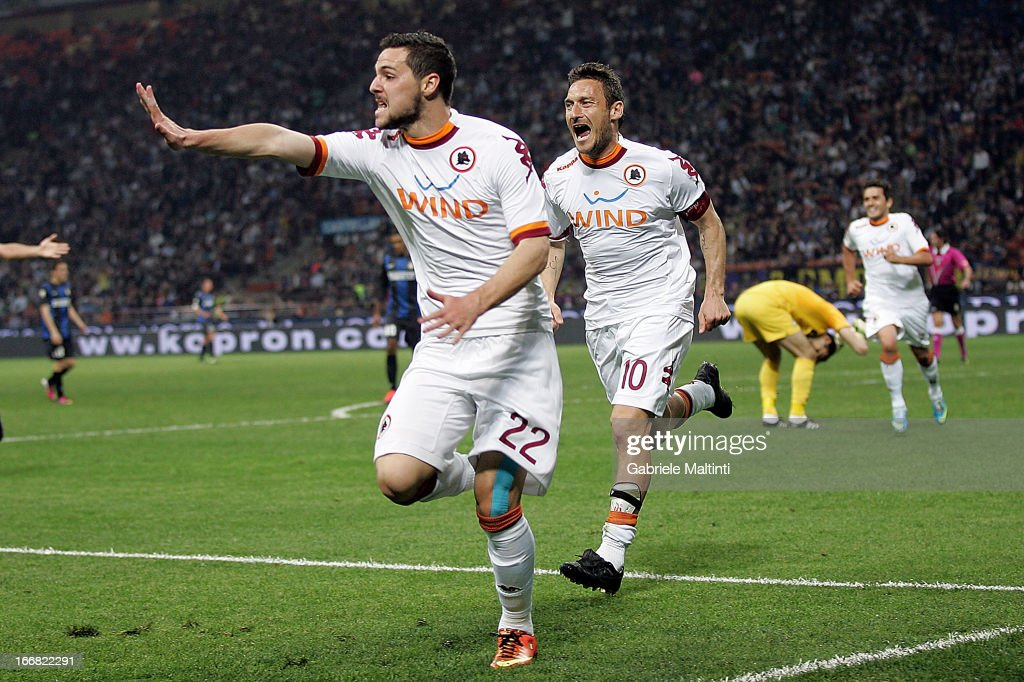 <a gi-track='captionPersonalityLinkClicked' href=/galleries/search?phrase=Mattia+Destro&family=editorial&specificpeople=5983870 ng-click='$event.stopPropagation()'>Mattia Destro</a> (L) of AS Roma celebrates after scoring a goal during the TIM Cup semifinal match between FC Internazionale Milano and AS Roma at Giuseppe Meazza Stadium on April 17, 2013 in Milan, Italy.