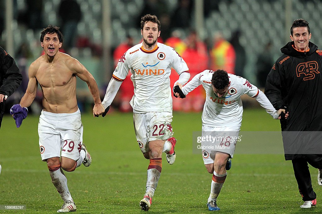 <a gi-track='captionPersonalityLinkClicked' href=/galleries/search?phrase=Mattia+Destro&family=editorial&specificpeople=5983870 ng-click='$event.stopPropagation()'>Mattia Destro</a> of AS Roma celebrates the victory after the TIM cup match between ACF Fiorentina and AS Roma at Artemio Franchi on January 16, 2013 in Florence, Italy.