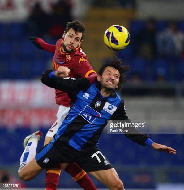 Mattia Destro of AS Roma competes for the ball with Cristian Raimondi of Atalanta BC during the TIM Cup match between AS Roma and Atalanta BC at...