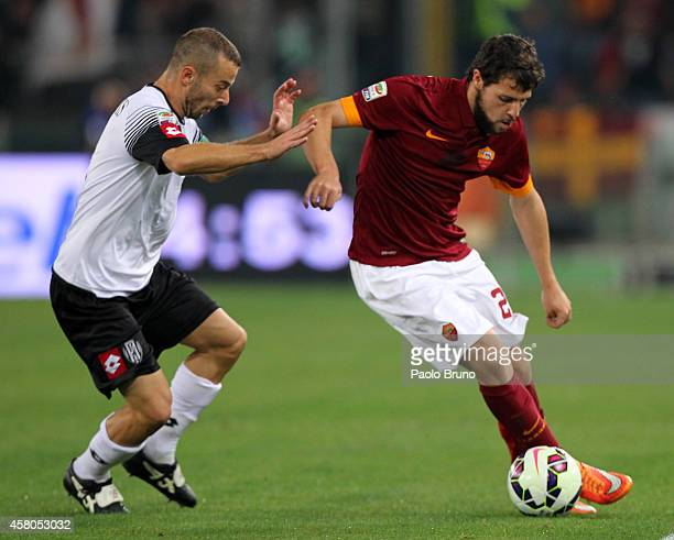 Mattia Destro of AS Roma competes for the ball with Giuseppe De Feudis of AC Cesena during the Serie A match between AS Roma and AC Cesena at Stadio...
