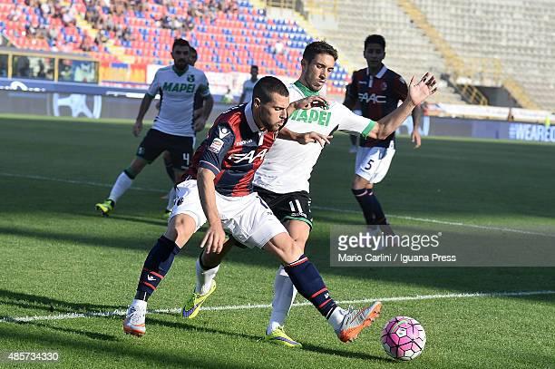 Mattia Destro of Bologna FC competes the ball with Sime Vrsaljko of US Sassuolo Calcio during the Serie A match between Bologna FC and US Sassuolo...