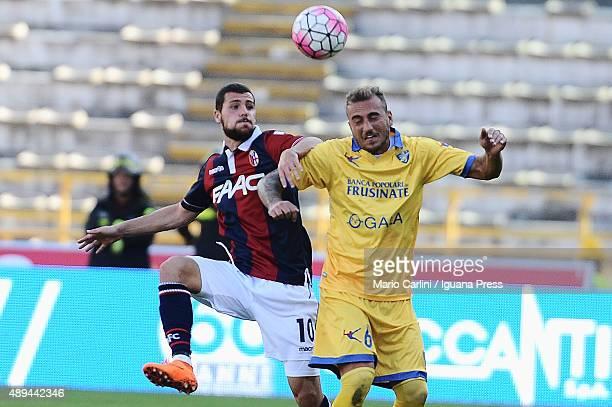 Mattia Destro of Bologna FC compets the ball with Leonardo Blanchard of Frosinone Calcio during the Serie A match between Bologna FC and Frosinone...