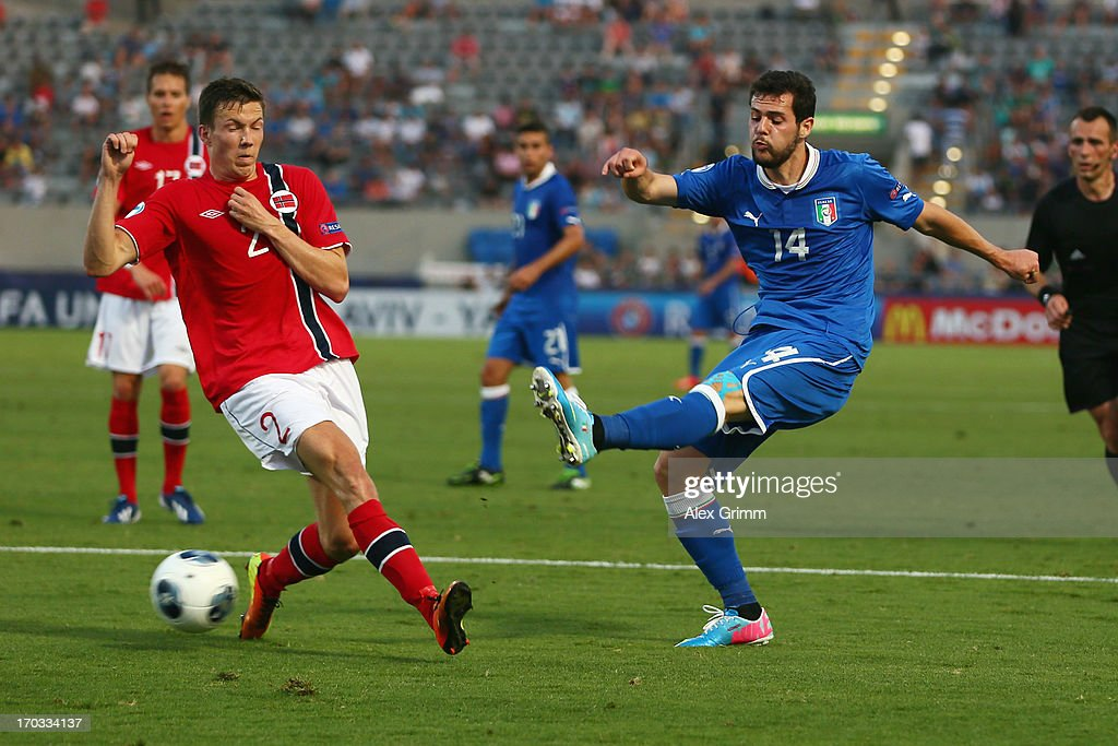 Mattia Destro (R) of Italy tries to score against Martin Linnes of Norway during the UEFA European U21 Championship Group A match between Norway and Italy at Bloomfield Stadium on June 11, 2013 in Tel Aviv, Israel.