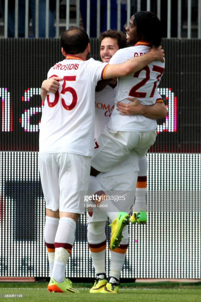 <a gi-track='captionPersonalityLinkClicked' href=/galleries/search?phrase=Mattia+Destro&family=editorial&specificpeople=5983870 ng-click='$event.stopPropagation()'>Mattia Destro</a> (C) of Roma celebrates with his team-mates after scoring their third goal and completing a hat-trick during the Serie A match between Cagliari Calcio and AS Roma at Stadio Sant'Elia on April 6, 2014 in Cagliari, Italy. (Photo by Enrico Locci/Getty Images