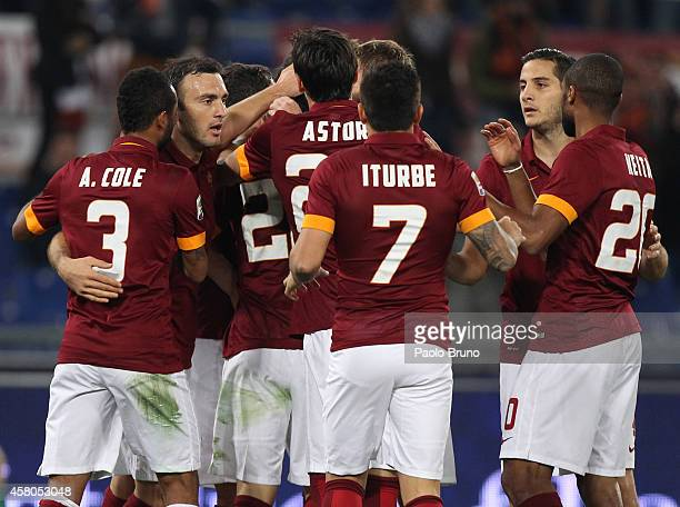 Mattia Destro with his teammates of AS Roma celebrates after scoring the opening goal during the Serie A match between AS Roma and AC Cesena at...