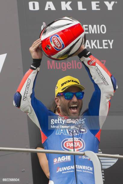 Mattia Pasini of Italy and Italtrans Racing Team celebrates the victory on the podium at the end of the Moto2 race during the MotoGp of Italy Race at...