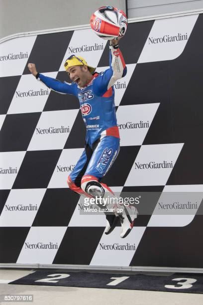 Mattia Pasini of Italy and Italtrans Racing Team celebrates the pole podition at the end of the qualifying practice during the MotoGp of Austria...