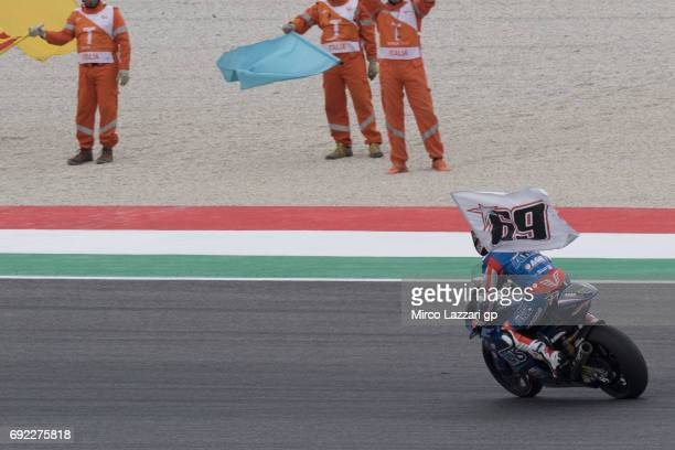 Mattia Pasini of Italy and Italtrans Racing Team celebrates the victory with the flag of Nicky Hayden at the end of the Moto2 race during the MotoGp...